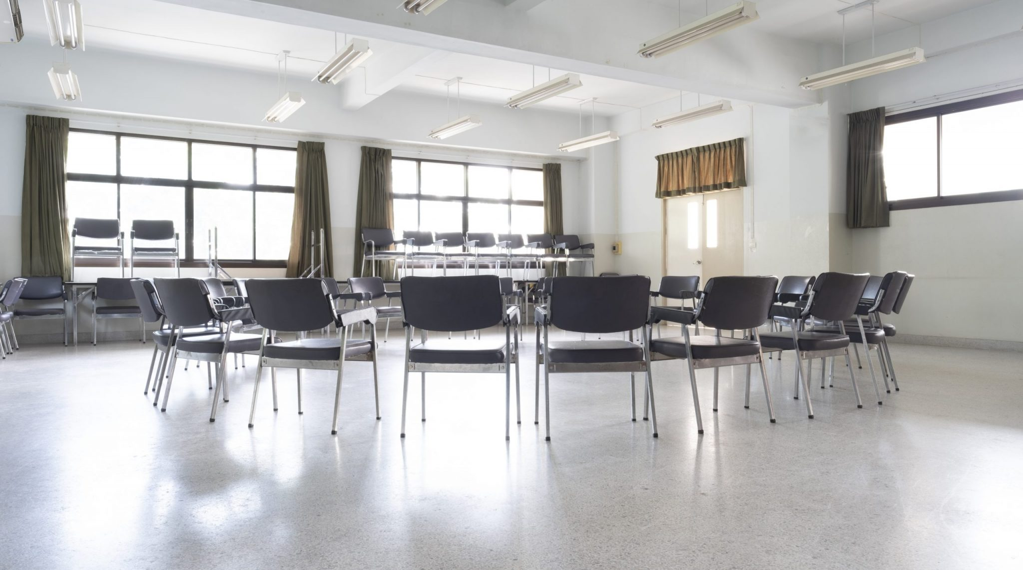 Empty chairs in a circle at an Alcoholics Anonymous recovery meeting